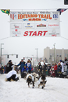 James Volek and team leave the ceremonial start line at 4th Avenue and D street in downtown Anchorage during the 2013 Iditarod race. Photo by Jim R. Kohl/IditarodPhotos.com