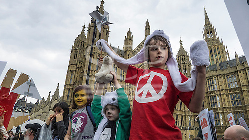 A group of children demonstrate in front of the Houses of Parliament during the Climate Change demonstration, London, 21st September 2014. © Sue Cunningham