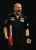 29.12.2015. Alexandra Palace, London, England. William Hill PDC World Darts Championship. Raymond van Barneveld celebrates his shock win over Michael van Gerwen,as his thrown dart lands just in front of him