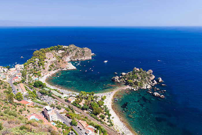 Isola Bella Island and Isola Bella Beach, Taormina, Sicily, Italy, Europe. This is a photo of Isola Bella Island in the Ionian Sea at Isola Bella Beach, Taormina, Sicily, Italy, Europe. Isola Bella Beach is the most popular beach at Taormina due to its beautiful location in the bright blue Ionian Sea (part of the Mediterranean Sea) and the presence of Isola Bella Island, which tourists can walk to.