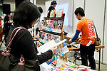 "A woman reads an anime book at the  the Niconico Douga fan event at Makuhari Messe International Exhibition Hall on April 25, 2015, Chiba, Japan. The event includes special attractions such as J-pop concerts, Sumo and Pro Wrestling matches, cosplay and manga and various robot performances and is broadcast live on via the video-sharing site. Niconico Douga (in English ""Smiley, Smiley Video"") is one of Japan's biggest video community sites where users can upload, view, share videos and write comments directly in real time, creating a sense of a shared watching. According to the organizers more than 200,000 viewers for two days will see the event by internet. The popular event is held in all 11 halls of the huge Makuhari Messe exhibition center from April 25 to 26. (Photo by Rodrigo Reyes Marin/AFLO)"