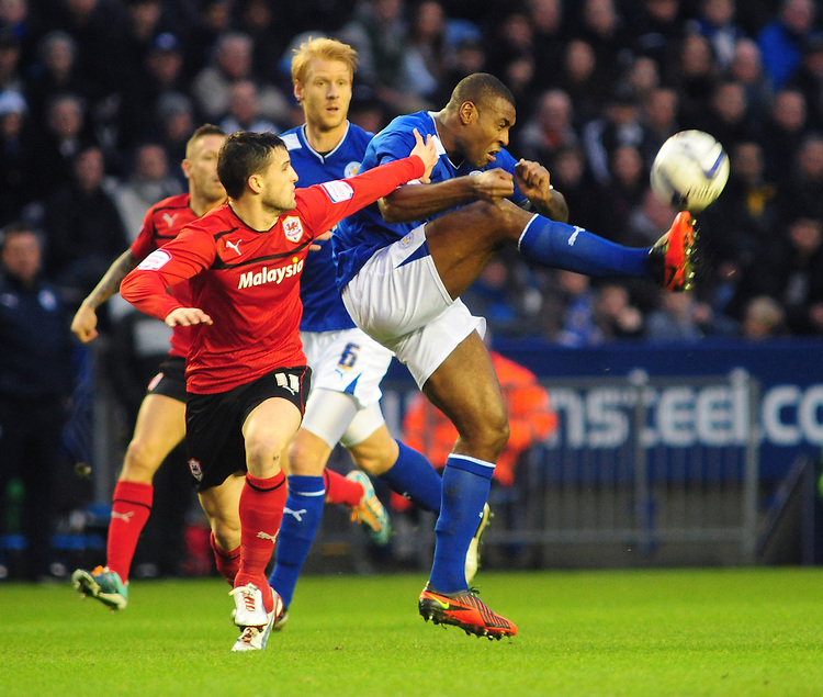 Leicester City's Wes Morgan clears under pressure from Cardiff City's Craig Conway ..Football - npower Football League Championship - Leicester City v Cardiff City - Saturday 22nd December 2012 - The King Power Stadium - Leicester..© CameraSport - 43 Linden Ave. Countesthorpe. Leicester. England. LE8 5PG - Tel: +44 (0) 116 277 4147 - admin@camerasport.com - www.camerasport.com