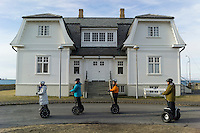 Reykjavik, Iceland - Tourists ride their Segway PTs past Hofoi, the site of the 1986 Reagan Gorbachev Summit, March 2016.