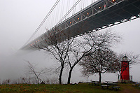 (070115-SWR034) New York, NY - 15 January - The Little Red Lighthouse and the Great Grey George Washington Bridge obscured by fog om an  unseasonablty warm and wet winter day.