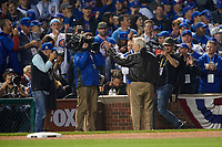 Chicago Cubs guest Marv Levy, the legendary coach of the Buffalo Bills, waves to the fans and TV cameras while being honored on the field in the fourth inning during Game 3 of the Major League Baseball World Series against the Cleveland Indians on October 28, 2016 at Wrigley Field in Chicago, Illinois.  (Mike Janes/Four Seam Images)