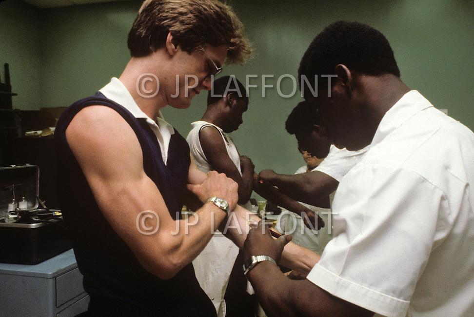 Fort Dix, NJ, USA, June 1980. Recruits receive several vaccinations.