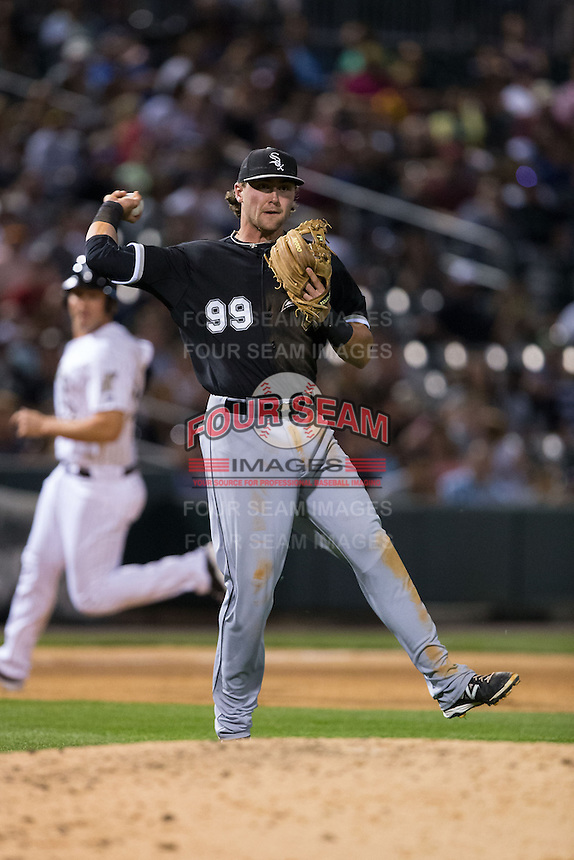 Chicago White Sox third baseman Trey Michalczewski (99) makes a throw to first base against the Charlotte Knights at BB&T Ballpark on April 3, 2015 in Charlotte, North Carolina.  The Knights defeated the White Sox 10-2.  (Brian Westerholt/Four Seam Images)