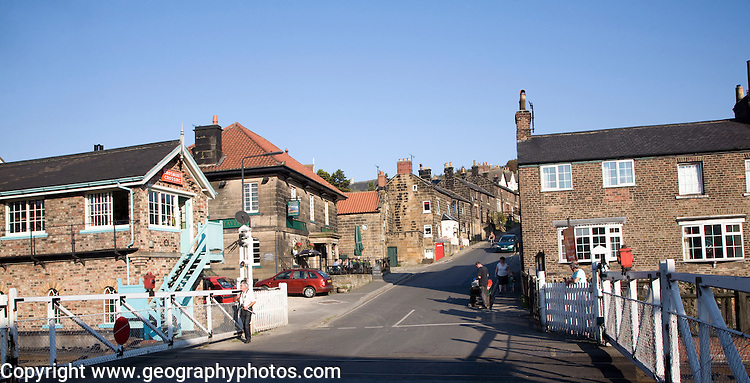 Railway level crossing and village houses, Grosmont, Yorkshire, England