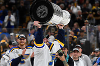 June 12, 2019: St. Louis Blues center Tyler Bozak (21) hoists the Stanley Cup at game 7 of the NHL Stanley Cup Finals between the St Louis Blues and the Boston Bruins held at TD Garden, in Boston, Mass.  The Saint Louis Blues defeat the Boston Bruins 4-1 in game 7 to win the 2019 Stanley Cup Championship.  Eric Canha/CSM.
