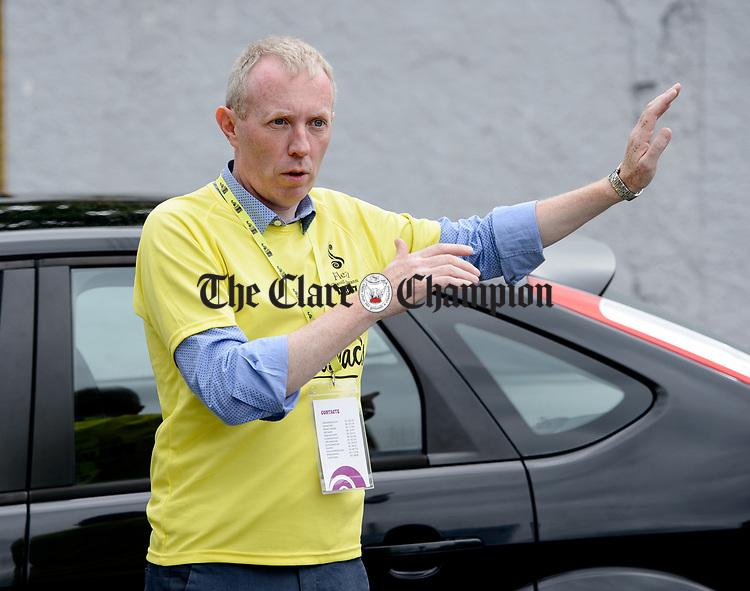 Volunteer Timmy Dooley, TD working as a traffic steward during Fleadh Cheoil na hEireann in Ennis. Photograph by John Kelly.