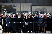Former staff members watch as the flag-draped casket of former President George H.W. Bush is carried by a joint services military honor guard to Special Air Mission 41, Wednesday, Dec. 5, 2018, at Andrews Air Force Base, Md. <br /> Credit: Alex Brandon / Pool via CNP