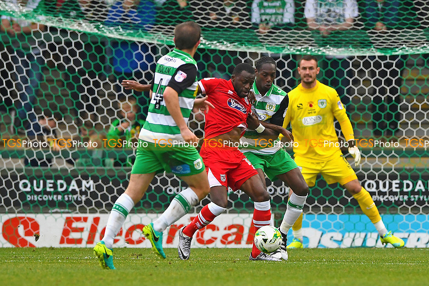 Yeovil Town defender Nathan Smith  keeps a tight hold on Tom Bolarinwa of Grimsby Townduring Yeovil Town vs Grimsby Town, Sky Bet EFL League 2 Football at Huish Park on 29th October 2016
