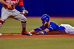 26 March 2018: Toronto Blue Jays catcher Russell Martin slides safely into second with a double in the first inning of a pre-season game against the St. Louis Cardinals at Olympic Stadium in Montreal, Quebec, Canada. The Cardinals defeated the Blue Jays 5-3 in the first of two MLB Grapefruit League games. Mandatory Credit: Ed Wolfstein Photo *** RAW (NEF) Image File Available ***