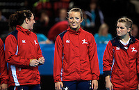 23 NOV 2011 - LONDON, GBR - Britain's Nina Heglund (centre) jokes with team mates Louise Jukes (left) and Zoe van der Weel (right) as they notice her black eye whilst lined up before the start of their 2011 London Handball Cup match against Angola at The Handball Arena in the Olympic Park in Stratford, London (PHOTO (C) NIGEL FARROW)