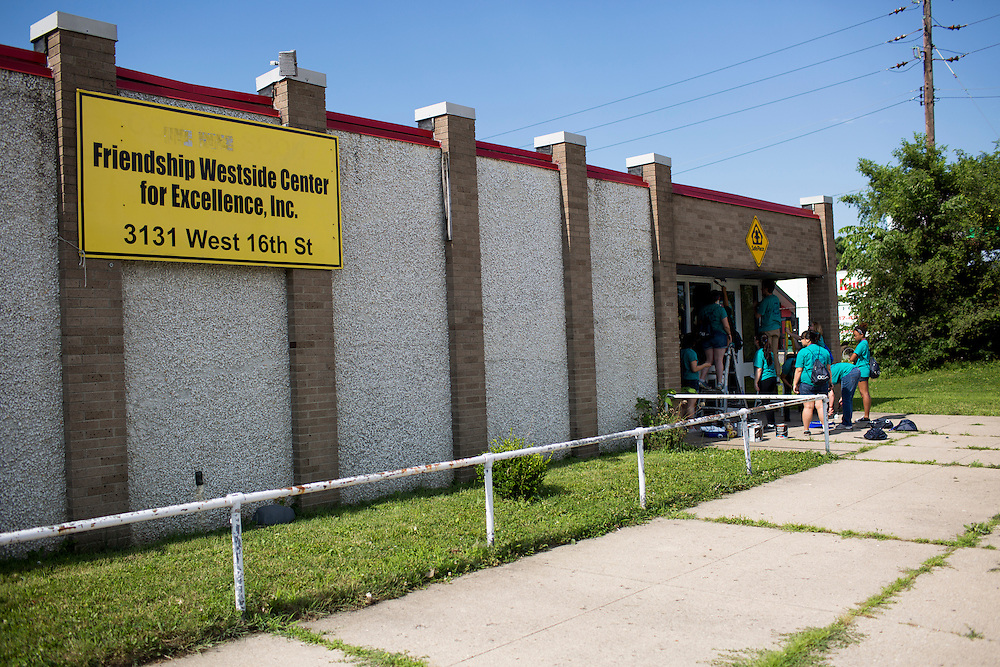 "Members work outside the front entrance to the Friendship Westside Center for Excellence during ""Circle the City with Service,"" the Kiwanis Circle K International's 2015 Large Scale Service Project, on Wednesday, June 24, 2015, in Indianapolis. (Photo by James Brosher)"