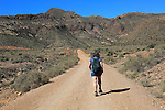 Woman walking in Cabo de Gata national park, Monsul, near San José, Almeria, Spain