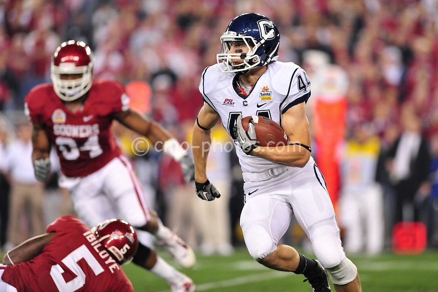 Jan 1, 2011; Glendale, AZ, USA; Connecticut Huskies running back Robbie Frey (44) runs the ball in the 1st quarter of the 2011 Fiesta Bowl against the Oklahoma Sooners at University of Phoenix Stadium.