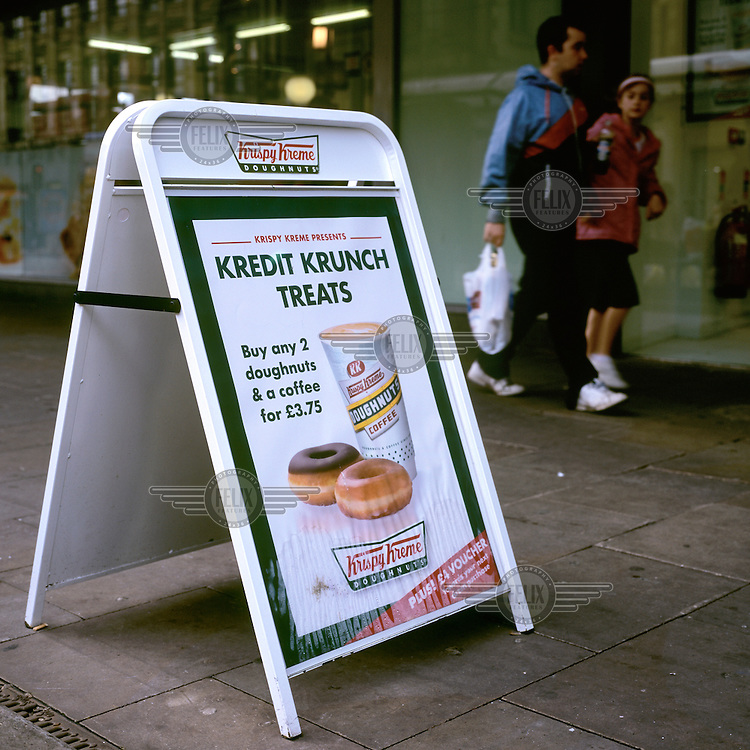 In response to the world's financial crisis, doughnut company Krispy Kreme offers a Kredit Krunch (credit crunch) special at a store in Manchester.