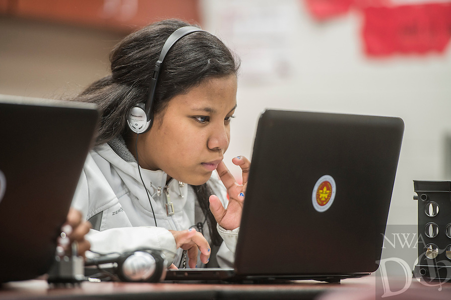 NWA Democrat-Gazette/ANTHONY REYES @NWATONYR<br /> Maria Larron, 13, does her homework on her computer Monday, Feb. 27, 2017 at an after school tutoring session at Hellstern Middle School in Springdale. On this day, they were getting started on their homework list for the week.