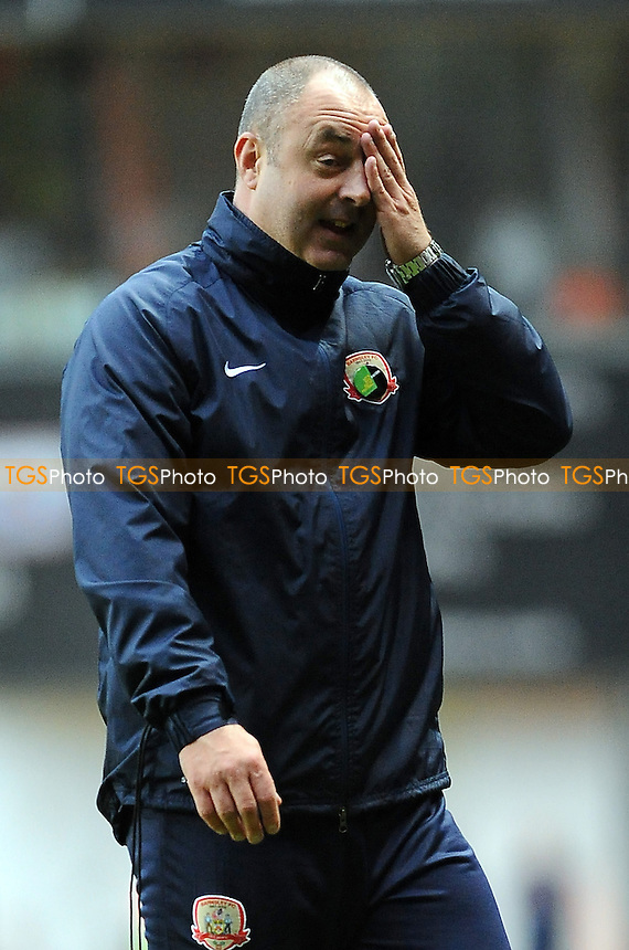 Barnsley manager Keith Hill wipes his brow after the match - Charlton Athletic vs Barnsley - NPower Championship Football at The Valley, London - 20/10/12 - MANDATORY CREDIT: Anne-Marie Sanderson/TGSPHOTO - Self billing applies where appropriate - 0845 094 6026 - contact@tgsphoto.co.uk - NO UNPAID USE.