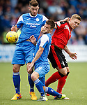 Martyn Waghorn grapples with Andy Dowie and Darren Brownlie
