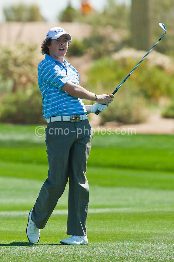 Feb 25, 2009; Marana, AZ, USA; Rory McIlroy (XNI) watches a shot on the 10th hole during the first round of the World Golf Championships-Accenture Match Play Championship at the Ritz-Carlton Golf Club, Dove Mountain.