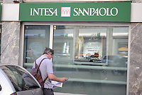 - Milan, bank Intesa Sanpaolo in Larga street<br /> <br /> - Milano, banca Intesa Sanpaolo in via Larga