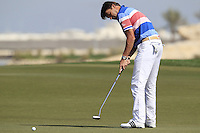 Robert-Jan Derksen (NED) putts on the par3 13th green during Friday's Round 3 of the Commercial Bank Qatar Masters 2013 at Doha Golf Club, Doha, Qatar 25th January 2013 .Photo Eoin Clarke/www.golffile.ie