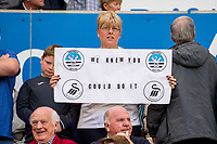 """A woman holds up a sign reading """"we knew you could do it"""" during the Premier League match between Swansea City and West Bromwich Albion at The Liberty Stadium, Swansea, Wales, UK. Sunday 21 May 2017 (Photo by Athena Pictures/Getty Images)"""