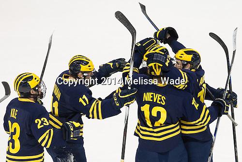 Alex Kile (Michigan - 23), Zach Hyman (Michigan - 11), Boo Nieves (Michigan - 12) and Dylan Larkin (Michigan - 19) celebrate Zach Werenski's (Michigan - 13) goal. - The Boston University Terriers defeated the visiting University of Michigan Wolverines 3-2 on Saturday, October 25, 2014, at Agganis Arena in Boston, Massachusetts.