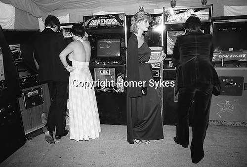 Playing Space Invaders machine at the Berkley Square Ball. London 1981.