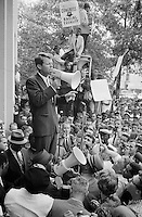 Washington, D.C USA - 1963 Jun. 14.-<br /> Attorney General Robert F. Kennedy speaking to a crowd of African Americans and whites through a megaphone outside the Justice Department; sign for Congress of Racial Equality is prominently displayed.<br /> Negro demonstration in Washington, D.C. Justice Dept. Bobby Kennedy speaking to crowd