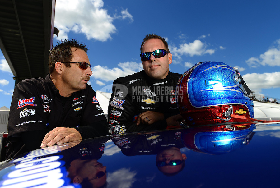 Sept 8, 2012; Clermont, IN, USA: NHRA pro stock driver Greg Anderson (left) talks with teammate Jason Line during qualifying for the US Nationals at Lucas Oil Raceway. Mandatory Credit: Mark J. Rebilas-