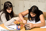 Education High School physics lab on electrical circuits two female students working together horizontal