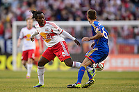 Peguy Luyindula (8) of the New York Red Bulls plays the ball through the legs of Jose Mari (6) of the Colorado Rapids. The New York Red Bulls and the Colorado Rapids played to a 1-1 tie during a Major League Soccer (MLS) match at Red Bull Arena in Harrison, NJ, on March 15, 2014.