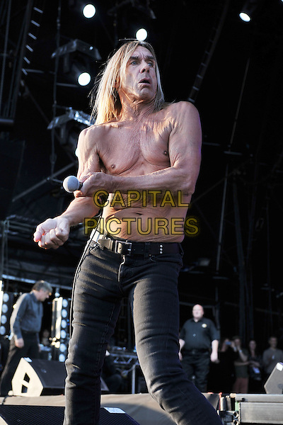 IGGY AND THE STOOGES (Iggy Pop (born James Newell Osterberg)).Day 2 of the Hop Farm Festival, nr Paddock Wood, Kent, England..July 2nd 2011 .stage concert live gig performance music half 3/4 length black jeans denim chest topless skin wrinkles wrinkled veins  dance dancing .CAP/MAR.© Martin Harris/Capital Pictures.