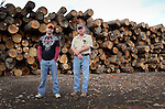 Johnny Henson and Bob Woford, log buyers, stand in front of logs they have recently purchased from local loggers near the city of Jackson in Breathitt County, KY.  These logs will be transported to a saw mill in Hydon, KY.  Johnny has been buying logs for over 12 years, and Bob has been a master logger for over 50 years. Photo by Amy Gaskin