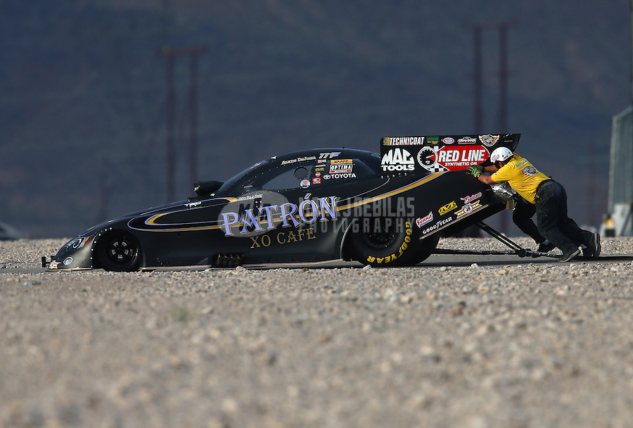 Mar 29, 2014; Las Vegas, NV, USA; The Safety Safari pushes NHRA funny car driver Alexis DeJoria off the track and out of harm's way during qualifying for the Summitracing.com Nationals at The Strip at Las Vegas Motor Speedway. Mandatory Credit: Mark J. Rebilas-