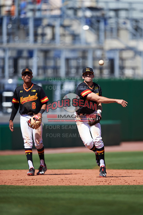 Maryland Terrapins shortstop Kevin Smith (4) throws to first base as third baseman AJ Lee (6) looks on during a game against the Alabama State Hornets on February 19, 2017 at Spectrum Field in Clearwater, Florida.  Maryland defeated Alabama State 9-7.  (Mike Janes/Four Seam Images)