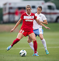Stephanie Ochs (22) of the Washington Spirit tries to hold off Sonja Fuss (22) of the Chicago Red Stars during the game at the Maryland SoccerPlex in Boyds, Md.   Chicago defeated Washington, 2-0.