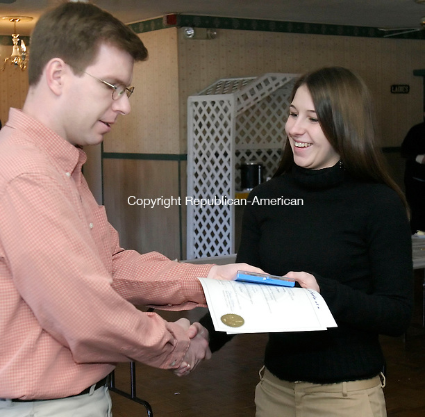 WATERTOWN, CT 08 January 2005 -010805BZ01-   Kris Kuegler, Watertown High boys and girls cross country coach, presents a certificate and medal to All-NVL cross country runner Jess Pepin at the Water-Oak Gold Circle of Sports 23rd annual All-NVL breakfast at the American Legion Post 195 hall Sunday morning.  The girls cross country team won the NVL championship and had three runners named All-NVL.<br /> Jamison C. Bazinet Republican-American