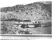 View of wagon bridge and gauging station at Embudo with northbound freight headed by two C-16 locomotives.<br /> D&amp;RG  Embudo, NM  6/4/1914
