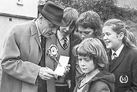 Perhaps looking to a future election Ulster Unionist South Down candidate Enoch Powell takes time to sign autographs for Newry High School pupils whilst campaigning in the border town. 197410020504g<br />
