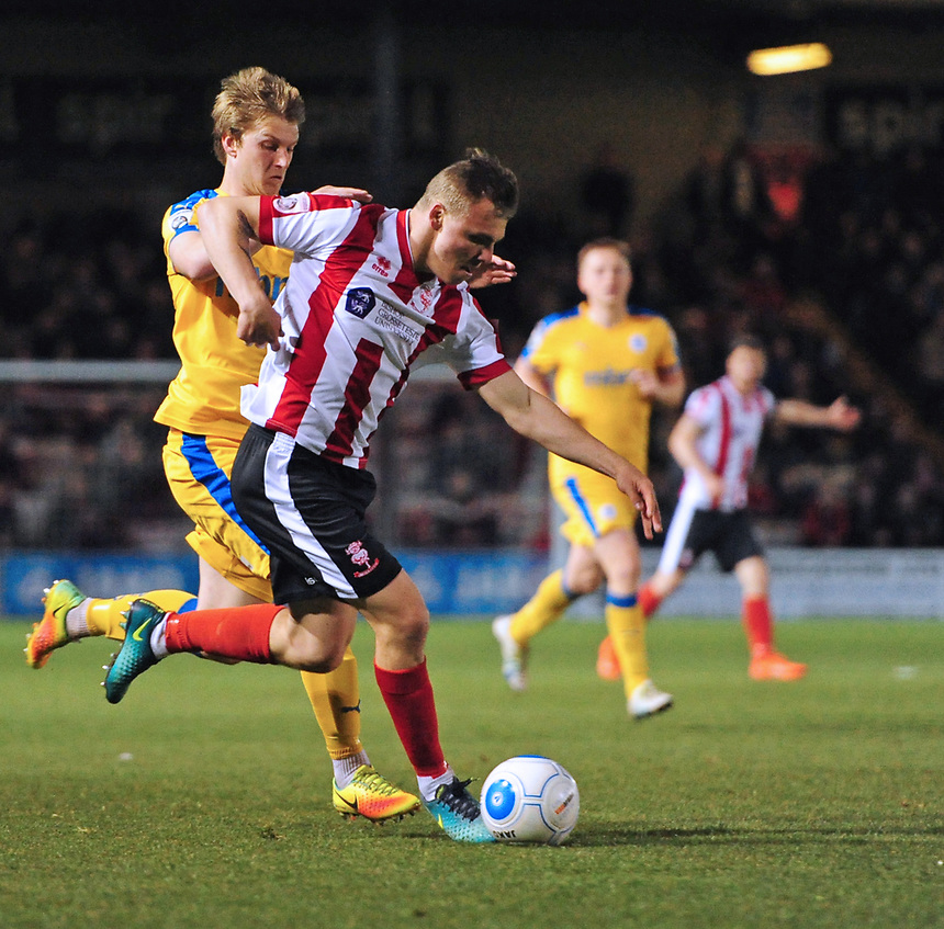 Lincoln City's Harry Anderson vies for possession with Chester's Ryan Lloyd<br /> <br /> Photographer Chris Vaughan/CameraSport<br /> <br /> Vanarama National League - Lincoln City v Chester - Tuesday 11th April 2017 - Sincil Bank - Lincoln<br /> <br /> World Copyright &copy; 2017 CameraSport. All rights reserved. 43 Linden Ave. Countesthorpe. Leicester. England. LE8 5PG - Tel: +44 (0) 116 277 4147 - admin@camerasport.com - www.camerasport.com