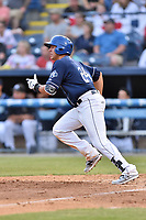 Asheville Tourists designated hitter Colton Welker (24)runs to first base during a game against the Greenville Drive at McCormick Field on April 15, 2017 in Asheville, North Carolina. The Tourists defeated the Drive 5-4. (Tony Farlow/Four Seam Images)