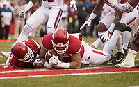 Hawgs Illustrated/BEN GOFF <br /> Kevin Richardson (30), Arkansas nickel back, and Briston Guidry (7), Arkansas defensive end, dive for the ball, with Guidry recovering for a touchdown, after McTelvin Agim (right), Arkansas defensive end, forced Nick Gibson (21), Mississippi State running back, to fumble in the first quarter Saturday, Nov. 18, 2017, at Reynolds Razorback Stadium in Fayetteville.