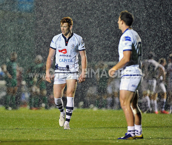 Jack Tovey looks on in the pouring rain during a break in play. Pre-season friendly match, between London Irish and Bristol Rugby on August 22, 2014 at Hazelwood in Middlesex, England. Photo by: Patrick Khachfe / JMP