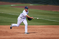 Lynchburg Hillcats first baseman Anthony Miller (40) flips the ball to the pitcher covering the bag during the first game of a doubleheader against the Potomac Nationals on June 9, 2018 at Calvin Falwell Field in Lynchburg, Virginia.  Lynchburg defeated Potomac 5-3.  (Mike Janes/Four Seam Images)