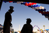 "Tempe, Arizona. October 13, 2012 - The silhouette of a man dressed as ""Uncle Sam"" who was standing on stilts was one of the attractions of a colorful non-partisan political rally where hundreds of registered voters learned more about local and presidential candidates. Hundreds of Arizona registered voters participated in a political rally where candidates for the US Senate, House of Representatives, state legislature, Maricopa County and other public offices pitched for votes for the upcoming general election. Photo by Eduardo Barraza © 2012"