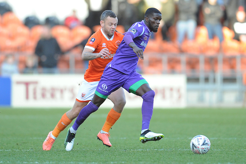 Maidstone United's Saidou Khan under pressure from Blackpool's Jay Spearing<br /> <br /> Photographer Kevin Barnes/CameraSport<br /> <br /> Emirates FA Cup Second Round - Blackpool v Maidstone United - Sunday 1st December 2019 - Bloomfield Road - Blackpool<br />  <br /> World Copyright © 2019 CameraSport. All rights reserved. 43 Linden Ave. Countesthorpe. Leicester. England. LE8 5PG - Tel: +44 (0) 116 277 4147 - admin@camerasport.com - www.camerasport.com